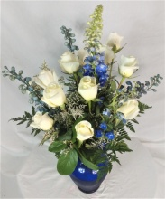 A Dozen Roses With Blue Flowers